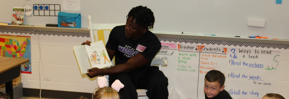 KWC football reading to our students