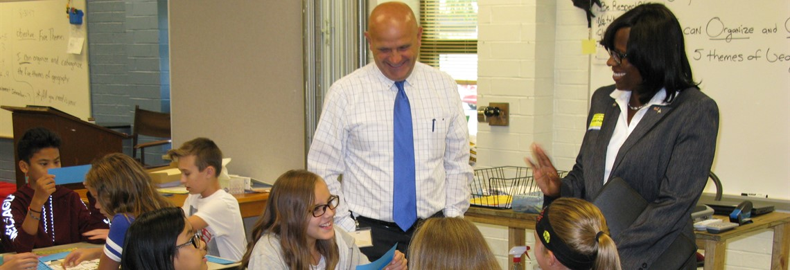 Lt. Governor Hampton and Assistant Principal, Larry Shadowen, visit with 6th grade BMS students.
