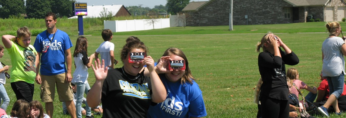 MRS. DAVIDSON AND MS. SMITH TRYING OUT THEIR SOLAR FILTER GLASSES