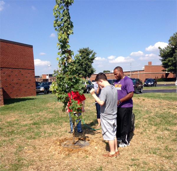 Mrs. Russelberg's Class Helps Water Mr Berry's Tree